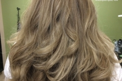 Full color with highlights and long layered haircut
