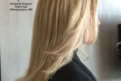 Full colored blonde highlights and long layered haircut