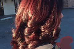 Vibrant red color and layered haircut