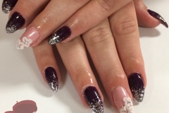 Acrylic nails sculpted by hand with gel polish and acrylic 3D nail art flowers