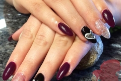 Gel polish change with free hand painted designs on sculptured acrylic nails