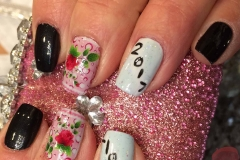 Polish change on natural nails using regular polish and floral nail art decal and a Happy New theme