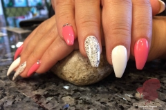 sculptured nails with gel polish and sparkle accents